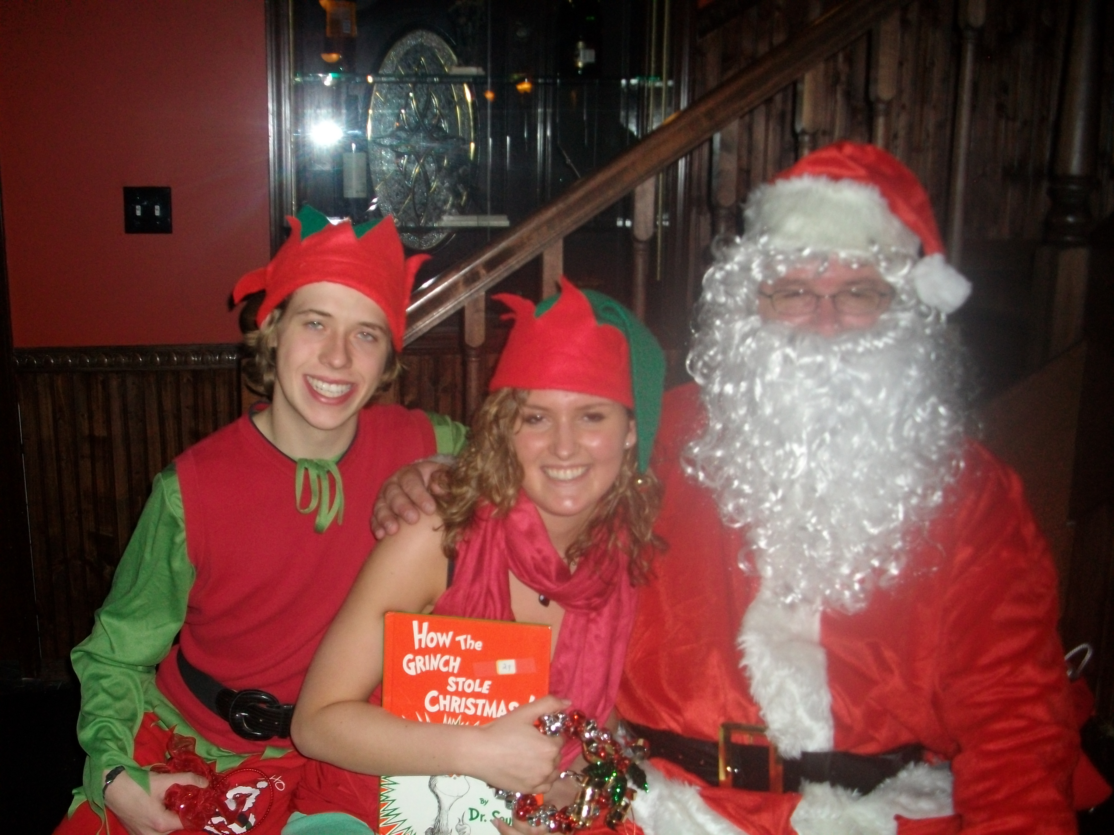 Tom Travis playing Santa with two helpers at a customer Christmas Party!